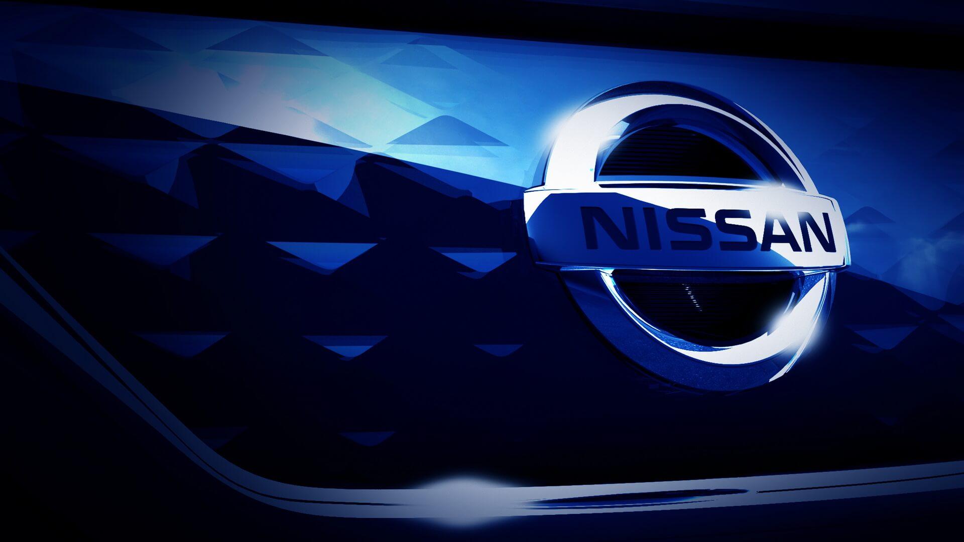 Фото значка бренда иребристой передней части бампера Nissan Leaf 2018