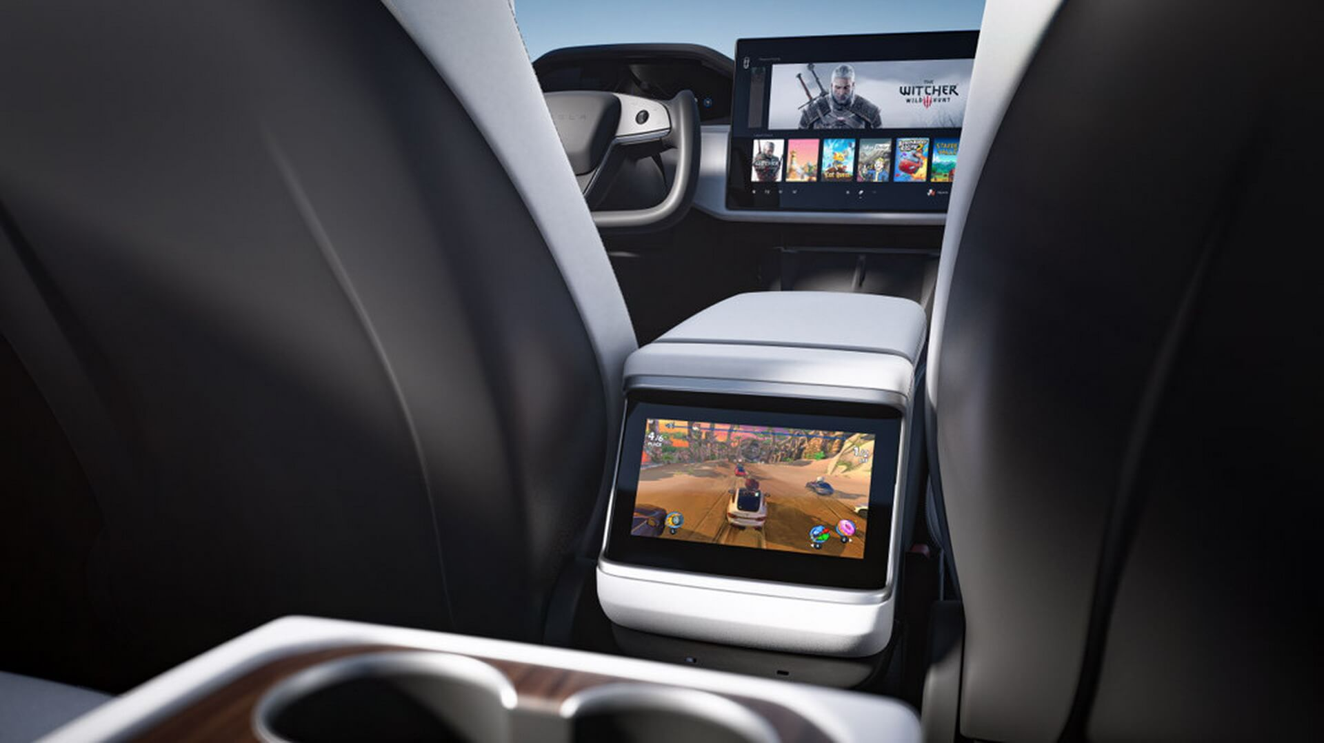 8-дюймовый сенсорный дисплей для второго ряда пассажиров, расположенный в центральной консоли новых Model S/X