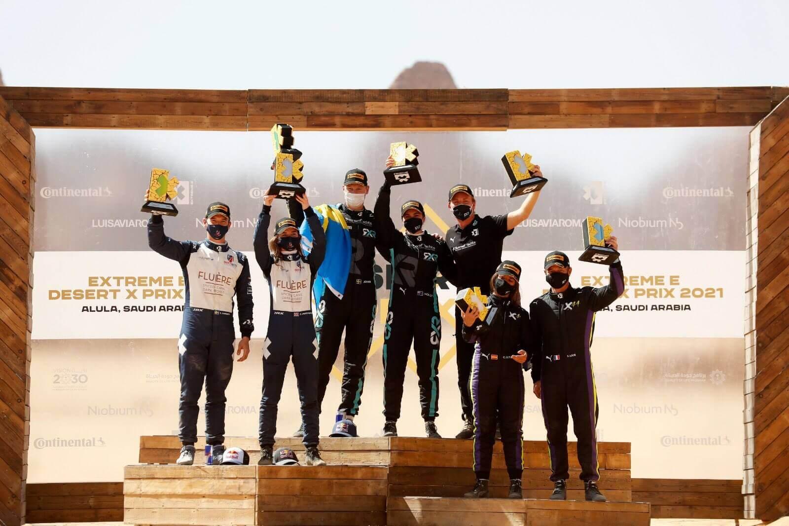 Тройка победителей дебютной гонки Extreme E в пустыне Саудовской Аравии Аль-Ула