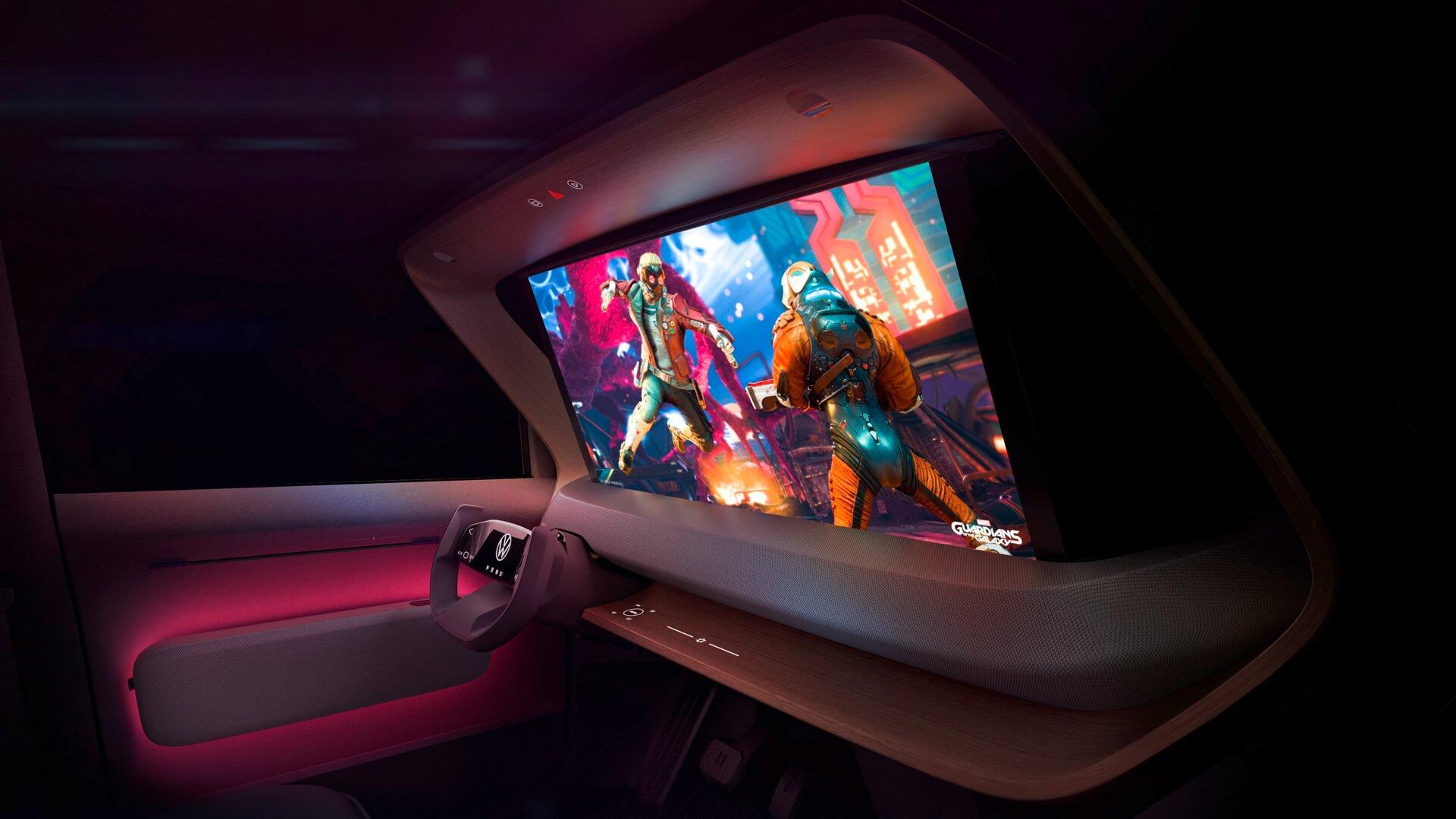 Концепт-кар Volkswagen ID. LIFE представлен с игровой консолью и проектором, который выводит изображение на экран, выдвигаемый перед лобовым стеклом